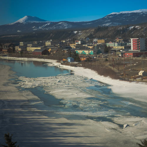 A magnificent view of the Yukon River on the outskirts of the city of Whitehorse, Yukon. This city can easily become a superb film location with its unique architectural style surrounded by mountains and forest as far as the eye can see.